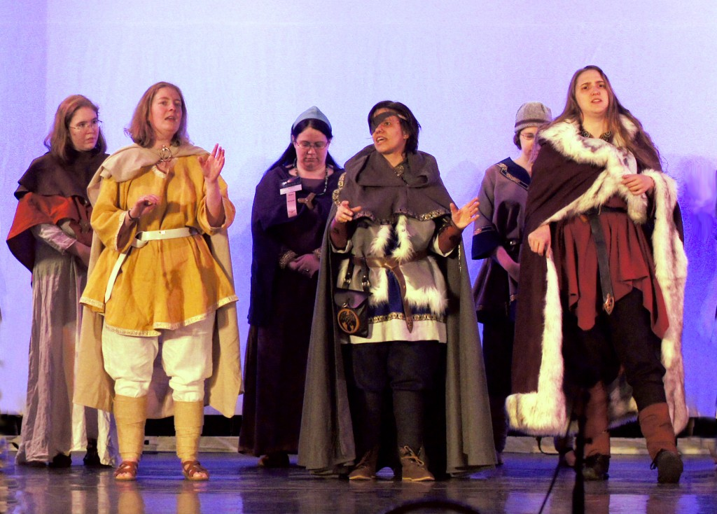 Baldur, Odin and Loki in their traveling cloaks, with chorus behind in more modest human costumes.